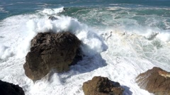 Slow Motion Ocean Waves Breaking on Rocks Stock Footage