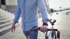 man on a bicycle with a smart clock - stock footage