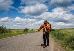 The Hitchhiker. Man Hitchhiking on a Country Road in Rural Nevada Desert. Men Kuvituskuvat