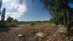 Wasteland On The Skirts Of The City, Skyscrapers In The Distance, Fish Eye Lens Stock Footage