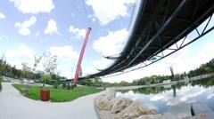 Beautiful Park Seen From Under Bid Round Bridge, Summer Day, Modern Design - stock footage