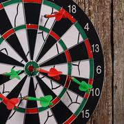 Darts on a wooden background Stock Photos