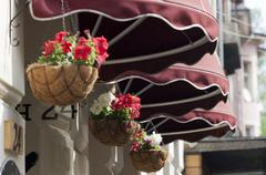 Awning and flowers - stock photo