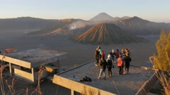 Tourists making photographs at viewpoint at sunrise,Bromo,Java,Indonesia - stock footage