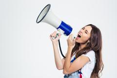 Woman screaming on loudspeaker - stock photo