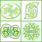 Bio label set with green leaf motif and inscription bio. Diffferent shapes in - stock illustration