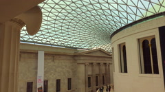 Visitors walk around the interior courtyard of the British Museum in London, Stock Footage