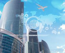 High-rise buildings with world map and icons Stock Illustration