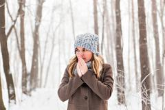 Portrait of a woman feeling cold in winter - outdoors Stock Photos