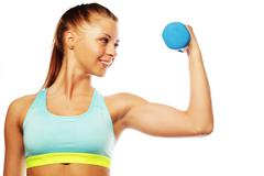 Woman in sport equipment practice with hand weights - stock photo