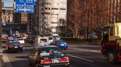 Tokyo traffic near Yasukuni Temple Stock Footage