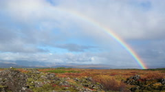 bright colorful rainbow over mossy rocky lava field Iceland 4k - stock footage