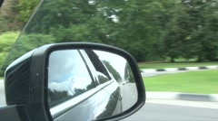 Reflected in the mirror of the road vehicle riding Stock Footage