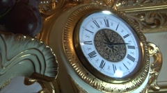 Beautiful clock in antique gold frame Stock Footage