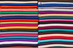 The stack of fabric for sell in the market - stock photo