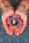 Stock Photo of Handmade Diwali Diya Lamp in Hand