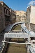 The under construction walkway along the canal through the medina in Fes Stock Photos