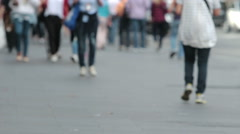 People walking out of focus: sidewalk, tourist, commuters Stock Footage