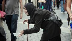 Woman asking for some money, charity: beggar, homeless, poor woman Stock Footage
