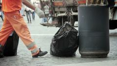 garbage collectors working in the city: scavengers, dustmen, trash collectors - stock footage