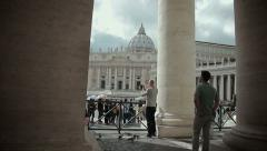 Tourists visiting the Bernini's colonnade and st. Peter's square and dome Stock Footage