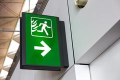 Fire Exit Sign Lightbox in the airport Stock Photos