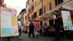 Outdoor tables of touristic restaurant in Rome, Italy Stock Footage