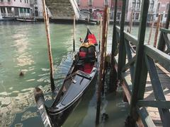 Gondola moored by quay on Venice canal, Italy - stock photo