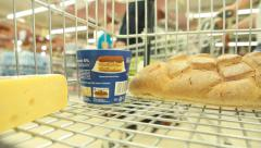 Bread and cheese in a basket in grocery store Stock Footage