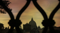 Sunset Views Of St. Peter's dome In Rome from a bridge: Vatican, Christianity - stock footage