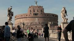 People walking near Castel Sant'angelo in Rome: tourist people, tourism in Rome Stock Footage