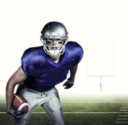 Composite image of portrait of american football player in uniform playing - stock photo