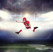 Composite image of american football player jumping with the ball Stock Photos