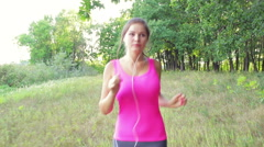 Young girl athlete runs on  a footpath in a park healthy lifestyle fresh air - stock footage