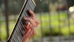 playing acoustic guitar outdoor in the street - stock footage