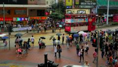 HONG KONG - October 2015: Traffic and people crossing street in city centre. Stock Footage