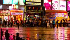 HONG KONG - October 2015: People crossing street in front of Chungking Mansions. Stock Footage