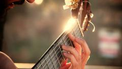 playing acoustic classical guitar in the street in Rome - stock footage