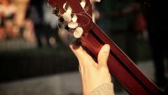 Playing acoustic classical guitar: street artist Stock Footage
