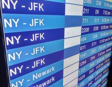 Arrivals display board at airport terminal Stock Photos