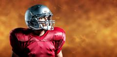 Stock Photo of Composite image of american football player looking away while standing