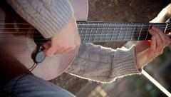 Guitarist playing acoustic guitar in the street: street artist Stock Footage