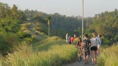 Cycling and walking on the ridge,Ubud,Bali,Indonesia Stock Footage