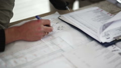 Engineer and worker checking blueprint work Stock Footage