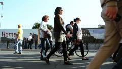 Side view of people walking in the street in Rome Stock Footage
