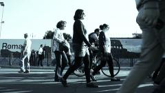 side view of people walking in the street in Rome - stock footage