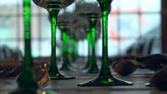 Stemmed glasses on dinner table in restaurant - Zoom in & out Stock Footage
