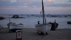 Sun setting, boats of Calella Stock Footage
