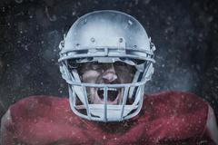 Stock Photo of Composite image of aggressive american football player in red jersey screaming