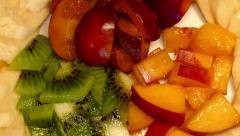 4k – Fruit salad on plate 02 Stock Footage